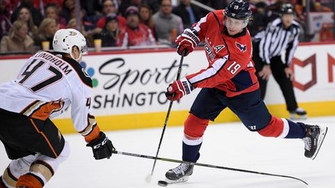 Washington Capitals center Nicklas Backstrom (19), of Sweden, shoots the puck against Anaheim Ducks defenseman Hampus Lindholm (47), Sweden, during the second period of an NHL hockey game, Saturday, Dec. 16, 2017, in Washington. (AP Photo/Nick Wass)