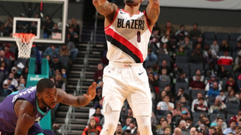 CHARLOTTE, NC - DECEMBER 16:  Damian Lillard #0 of the Portland Trail Blazers shoots the ball against the Charlotte Hornets on December 16, 2017 at Spectrum Center in Charlotte, North Carolina. NOTE TO USER: User expressly acknowledges and agrees that, by downloading and or using this photograph, User is consenting to the terms and conditions of the Getty Images License Agreement.  Mandatory Copyright Notice:  Copyright 2017 NBAE (Photo by Kent Smith/NBAE via Getty Images)