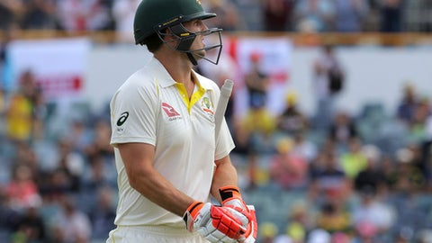 Australia's Mitchell Marsh leaves the ground after being dismissed on the second ball of the day from England during the fourth day of their Ashes cricket test match in Perth, Australia, Sunday, Dec. 17, 2017. (AP Photo/Trevor Collens)