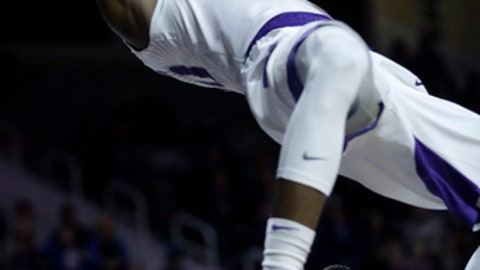 Kansas State forward Xavier Sneed (20) dunks over Southeast Missouri State guard Daniel Simmons (23) and Southeast Missouri State forward Milos Vranes, lower right, during the second half of an NCAA college basketball game in Manhattan, Kan., Saturday, Dec. 16, 2017. Kansas State defeated Southeast Missouri State 89-71. (AP Photo/Orlin Wagner)