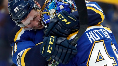 St. Louis Blues goalie Carter Hutton, right, gets a hug from teammate Vladimir Tarasenko, of Russia, after defeating the Winnipeg Jets in an NHL hockey game Saturday, Dec. 16, 2017, in St. Louis. (AP Photo/Jeff Roberson)