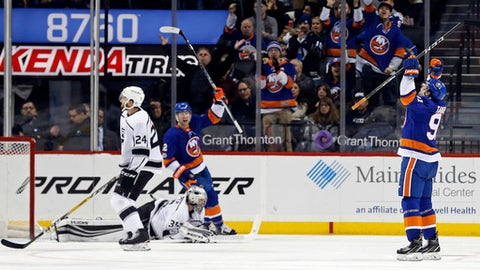 New York Islanders center John Tavares (91) celebrates scoring a goal past Los Angeles Kings goalie Darcy Kuemper in the third period of an NHL hockey game, Saturday, Dec. 16, 2017, in New York. The Islanders won 4-3 in overtime. (AP Photo/Adam Hunger)