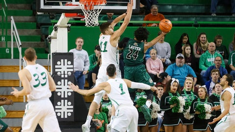 Marshall's Ajdin Penava (11) comes in to block the shot by Ohio's Mike Laster (24) during an NCAA college basketball game, Saturday, Dec. 16, 2017 in Huntington, W.Va. (Sholten Singer/The Herald-Dispatch via AP)