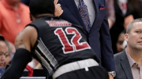 New Mexico State head coach Chris Jans, top, talks to guard AJ Harris during the second half of an NCAA college basketball game against Illinois, Saturday, Dec. 16, 2017, in Chicago. (AP Photo/Nam Y. Huh)