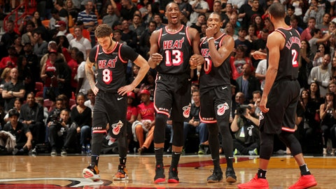 MIAMI, FL - DECEMBER 16: Tyler Johnson #8, Bam Adebayo #13, Josh Richardson #0, and Wayne Ellington #2 of the Miami Heat during the game against the LA Clippers on December 16, 2017 at American Airlines Arena in Miami, Florida. NOTE TO USER: User expressly acknowledges and agrees that, by downloading and/or using this photograph, user is consenting to the terms and conditions of the Getty Images License Agreement. Mandatory Copyright Notice: Copyright 2017 NBAE (Photo by Oscar Baldizon/NBAE via Getty Images)