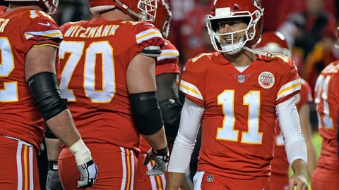 Kansas City Chiefs quarterback Alex Smith (11) smiles during the first half of an NFL football game against the Los Angeles Chargers in Kansas City, Mo., Saturday, Dec. 16, 2017. (AP Photo/Ed Zurga)