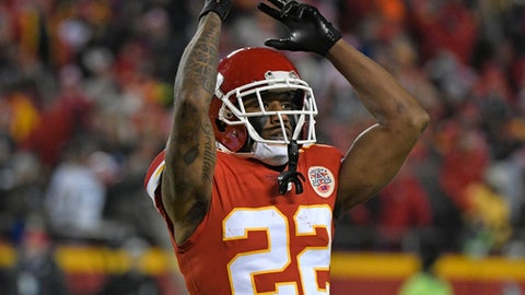Kansas City Chiefs defensive back Marcus Peters (22) celebrates after intercepting a pass by Los Angeles Chargers quarterback Philip Rivers (17) during the second half of an NFL football game in Kansas City, Mo., Saturday, Dec. 16, 2017. The Chiefs won, 30-13. (AP Photo/Ed Zurga)