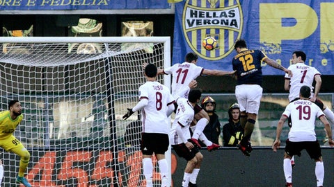 Verona's Antonio Caracciolo, third from right, scores during the Italian Serie A soccer match between Verona and Milan at Bentegodi stadium in Verona, Italy, Sunday, Dec. 17, 2017. (Simone Venezia/ANSA via AP)S