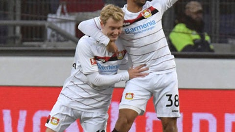 Leverkusen's Julian Brandt celebrating his opening goal along with teammate Karim Bellarabi, right, during the German Bundesliga soccer match between Hannover 96 and Bayer Leverkusen in Hannover, Germany, Sunday, Dec. 17, 2017.  (Peter Steffen/dpa via AP)