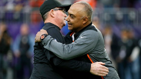 Minnesota Vikings head coach Mike Zimmer, left, embraces Cincinnati Bengals head coach Marvin Lewis before an NFL football game, Sunday, Dec. 17, 2017, in Minneapolis. (AP Photo/Bruce Kluckhohn)
