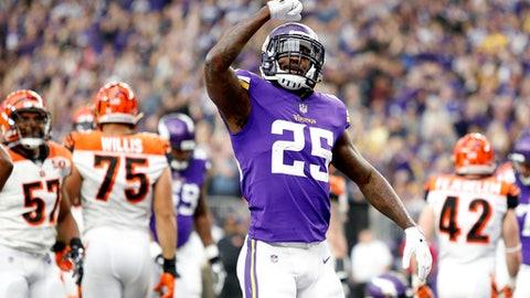 Minnesota Vikings running back Latavius Murray celebrates after scoring on a 1-yard touchdown run during the first half of an NFL football game against the Cincinnati Bengals, Sunday, Dec. 17, 2017, in Minneapolis. (AP Photo/Bruce Kluckhohn)