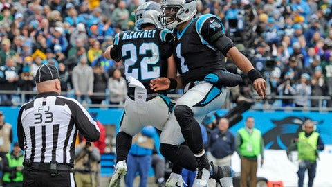 Carolina Panthers' Cam Newton (1) and Christian McCaffrey (22) celebrate McCaffrey's touchdown against the Green Bay Packers during the first half of an NFL football game in Charlotte, N.C., Sunday, Dec. 17, 2017. (AP Photo/Mike McCarn)