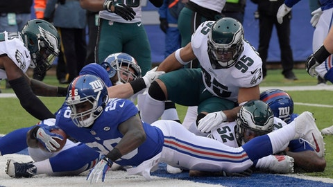 New York Giants running back Orleans Darkwa (26) dives into the endzone for a touchdown during the first half of an NFL football game against the Philadelphia Eagles, Sunday, Dec. 17, 2017, in East Rutherford, N.J. (AP Photo/Bill Kostroun)