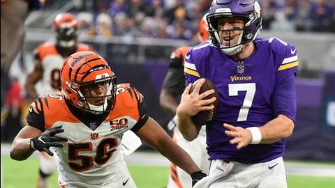 Minnesota Vikings quarterback Case Keenum (7) runs from Cincinnati Bengals linebacker Hardy Nickerson (56) during the first half of an NFL football game, Sunday, Dec. 17, 2017, in Minneapolis. (AP Photo/John Autey)