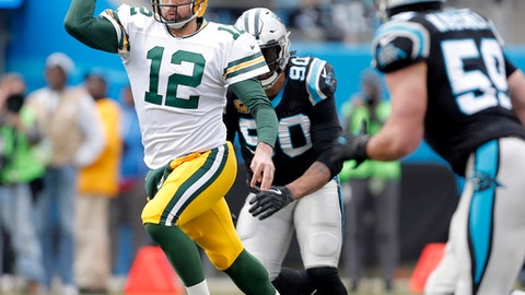 Green Bay Packers' Aaron Rodgers (12) scrambles against the Carolina Panthers during the first half of an NFL football game in Charlotte, N.C., Sunday, Dec. 17, 2017. (AP Photo/Bob Leverone)