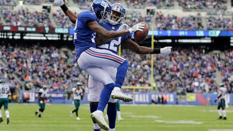 New York Giants wide receiver Tavarres King, left, and running back Wayne Gallman celebrate King's touchdown catch against the Philadelphia Eagles during the first half of an NFL football game Sunday, Dec. 17, 2017, in East Rutherford, N.J. (AP Photo/Seth Wenig)