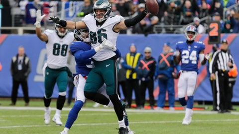 Philadelphia Eagles tight end Zach Ertz (86) scores on a touchdown pass from quarterback Nick Foles, not pictured, as New York Giants cornerback Andrew Adams tries to stop him during the first half of an NFL football game Sunday, Dec. 17, 2017, in East Rutherford, N.J. (AP Photo/Seth Wenig)