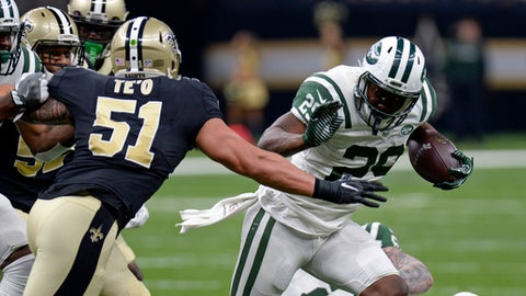 New York Jets running back Bilal Powell (29) carries against New Orleans Saints middle linebacker Manti Te'o (51) in the first half of an NFL football game in New Orleans, Sunday, Dec. 17, 2017. (AP Photo/Bill Feig)