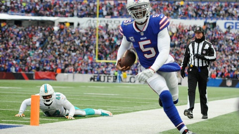 Buffalo Bills quarterback Tyrod Taylor (5) runs out of bounds after scoring a touchdown as Miami Dolphins' Stephone Anthony (44) watches during the first half of an NFL football game Sunday, Dec. 17, 2017, in Orchard Park, N.Y. (AP Photo/Adrian Kraus)