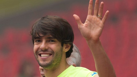 FILE-In this Friday, Oct. 10, 2014 file photo, Brazil's Kaka waves as he arrives for a training session ahead of a friendly match against Argentina at the Bird's Nest National Stadium in Beijing, China. Former Ballon d'Or winner Kaka says he is retiring from soccer at age 35, it was reported on Sunday, Dec. 17, 2017. (AP Photo/Ng Han Guan, File)