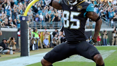Jacksonville Jaguars wide receiver Jaydon Mickens (85) celebrates his 15-yard touchdown catch against the Houston Texans during the first half of an NFL football game, Sunday, Dec. 17, 2017, in Jacksonville, Fla. (AP Photo/Phelan M. Ebenhack)