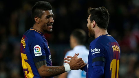 FC Barcelona's Paulinho, left, celebrates after scoring with his teammate Lionel Messi during the Spanish La Liga soccer match between FC Barcelona and Deportivo Coruna at the Camp Nou stadium in Barcelona, Spain, Sunday, Dec. 17, 2017. (AP Photo/Manu Fernandez)
