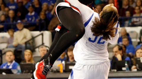 Louisville's Jazmine Jones (23) shoots while pressure by Kentucky's Jaida Roper (32) during the first half of an NCAA college basketball game, Sunday, Dec. 17, 2017, in Lexington, Ky. (AP Photo/James Crisp)