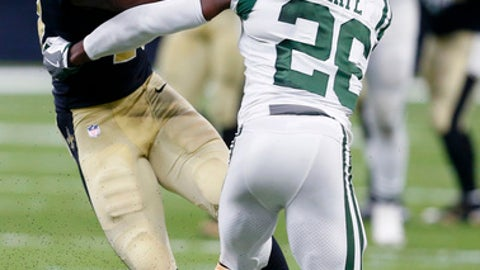 New Orleans Saints wide receiver Michael Thomas (13) carries against New York Jets free safety Marcus Maye (26) on a first down reception in the second half of an NFL football game in New Orleans, Sunday, Dec. 17, 2017. (AP Photo/Butch Dill)