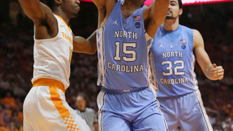 North Carolina forward Garrison Brooks (15) goes up for a basket in front of teammate Luke Maye (32) and Tennessee forward Kyle Alexander (11) in the first half of an NCAA college basketball game Sunday, Dec. 17, 2017, in Knoxville, Tenn. (AP Photo/Crystal LoGiudice)