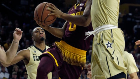 Arizona State guard Tra Holder (0) drives on Vanderbilt forward Jeff Roberson in the second half during an NCAA college basketball game, Sunday, Dec 17, 2017, in Tempe, Ariz. Arizona State defeated Vanderbilt 76-64. (AP Photo/Rick Scuteri)