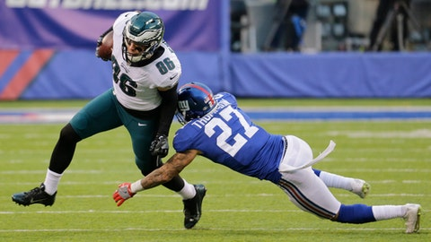 Philadelphia Eagles tight end Zach Ertz (86) avoids the tackle attempt of New York Giants free safety Darian Thompson (27) during the second half of an NFL football game Sunday, Dec. 17, 2017, in East Rutherford, N.J. (AP Photo/Seth Wenig)