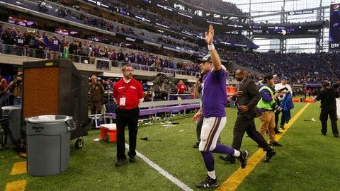 Minnesota Vikings quarterback Case Keenum waves to fans as he runs off the field after an NFL football game against the Cincinnati Bengals, Sunday, Dec. 17, 2017, in Minneapolis. (AP Photo/Bruce Kluckhohn)