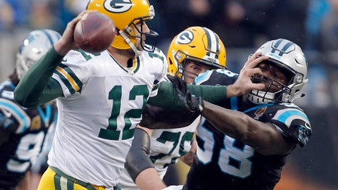 Green Bay Packers' Aaron Rodgers (12) blocks Carolina Panthers' Thomas Davis (58) during the second half of an NFL football game in Charlotte, N.C., Sunday, Dec. 17, 2017. (AP Photo/Bob Leverone)