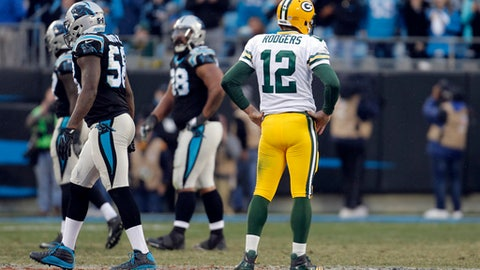 Green Bay Packers' Aaron Rodgers (12) watches as Carolina Panthers players walk off the field after a Green Bay Packers fumble late during the second half of an NFL football game in Charlotte, N.C., Sunday, Dec. 17, 2017. (AP Photo/Bob Leverone)