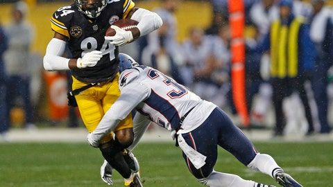 Pittsburgh Steelers wide receiver Antonio Brown (84) is tackled by New England Patriots free safety Devin McCourty (32) during the first half of an NFL football game in Pittsburgh, Sunday, Dec. 17, 2017. (AP Photo/Keith Srakocic)
