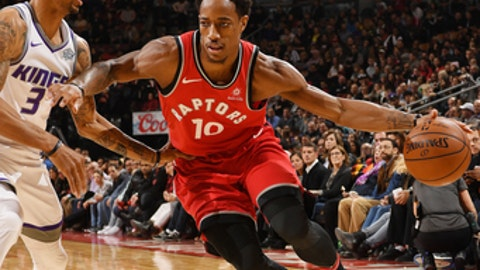 TORONTO, CANADA - DECEMBER 17:   DeMar DeRozan #10 of the Toronto Raptors handles the ball against the Sacramento Kings on December 17, 2017 at the Air Canada Centre in Toronto, Ontario, Canada.  NOTE TO USER: User expressly acknowledges and agrees that, by downloading and or using this Photograph, user is consenting to the terms and conditions of the Getty Images License Agreement.  Mandatory Copyright Notice: Copyright 2017 NBAE (Photo by Ron Turenne/NBAE via Getty Images)