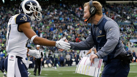 Los Angeles Rams head coach Sean McVay, right, greets wide receiver Robert Woods, left, after Rams' Todd Gurley scored a touchdown in the first half of an NFL football game, Sunday, Dec. 17, 2017, in Seattle. (AP Photo/John Froschauer)