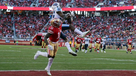 Tennessee Titans cornerback Adoree' Jackson, top, breaks up a pass in the end zone intended for San Francisco 49ers wide receiver Marquise Goodwin (11) during the second half of an NFL football game, Sunday, Dec. 17, 2017, in Santa Clara, Calif. (AP Photo/John Hefti)