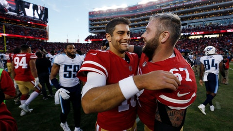 San Francisco 49ers quarterback Jimmy Garoppolo, center, hugs teammate Daniel Kilgore after a 25-23 win over the Tennessee Titans during an NFL football game Sunday, Dec. 17, 2017, in Santa Clara, Calif. (AP Photo/D. Ross Cameron)