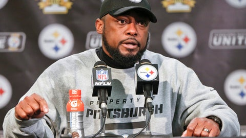 Pittsburgh Steelers head coach Mike Tomlin takes questions during the news conference after an NFL football game against the New England Patriots, Sunday, Dec. 17, 2017, in Pittsburgh. The Patriots won 27-24. (AP Photo/Keith Srakocic)