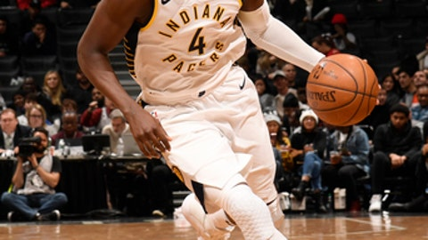 BROOKLYN, NY - DECEMBER 17:   Victor Oladipo #4 of the Indiana Pacers handles the ball against the Brooklyn Nets on December 17, 2017 at Barclays Center in Brooklyn, New York. NOTE TO USER: User expressly acknowledges and agrees that, by downloading and or using this Photograph, user is consenting to the terms and conditions of the Getty Images License Agreement. Mandatory Copyright Notice: Copyright 2017 NBAE (Photo by Brian Babineau/NBAE via Getty Images)