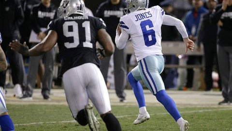 Dallas Cowboys punter Chris Jones (6) runs on a fake punt against the Oakland Raiders during the second half of an NFL football game in Oakland, Calif., Sunday, Dec. 17, 2017. (AP Photo/Eric Risberg)