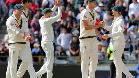 Australian players, from left to right, David Warner, Mitchell Starc, Nathan Lyon, Josh Hazlewood and Steve Smith celebrate winning their Ashes cricket test match against England in Perth, Australia, Monday, Dec. 18, 2017. Australia won by an innings and 41 runs. (AP Photo/Trevor Collens)