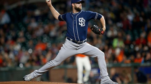 FILE - In this Sept. 29, 2017, file photo, San Diego Padres pitcher Jordan Lyles throws to the San Francisco Giants during the first inning of a baseball game, in San Francisco. Lyles and the Padres have agreed to a $1 million, one-year contract, Sunday, Dec. 17, 2017, that includes a club option for 2019.(AP Photo/Tony Avelar, File)