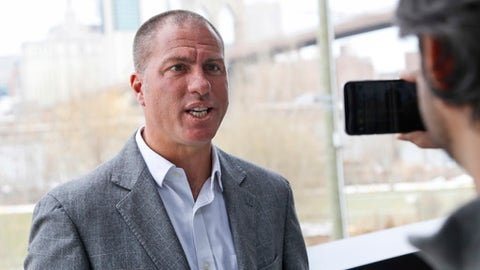 New York Cosmos head coach Giovanni Savarese speak to a reporter during a news conference in the Brooklyn borough of New York, Tuesday, March 21, 2017. The team was on the verge of shutting down before it was acquired by Rocco Commisso in December 2016. Their first game is in Puerto Rico on Mar 25, 2017 and their home opener will be at MCU Park in Coney Island on Apr. 1, 2017. (AP Photo/Seth Wenig)