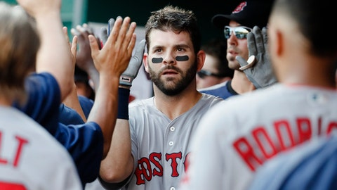 FILE - This Sept. 23, 2017 file photo shows Boston Red Sox's Mitch Moreland celebrating in the dugout after hitting a three-run home run off Cincinnati Reds starting pitcher Robert Stephenson in the sixth inning of a baseball game in Cincinnati. Moreland is remaining with the Red Sox, agreeing to a $13 million, two-year contract, Monday, Dec. 18, 2017. (AP Photo/John Minchillo, file)