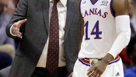 Kansas head coach Bill Self, left, talks with guard Malik Newman (14) during the first half of an NCAA college basketball game against Nebraska-Omaha in Lawrence, Kan., Monday, Dec. 18, 2017. (AP Photo/Orlin Wagner)