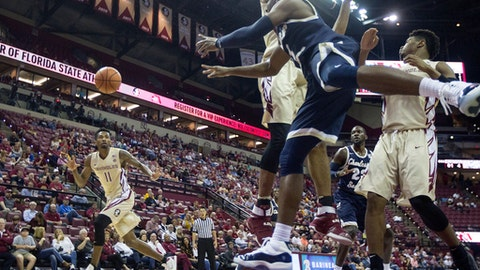 Florida State guard Braian Angola moves to intercept a Charleston Southern pass by Cortez Mitchell in the first half of an NCAA college basketball game in Tallahassee, Fla., Monday, Dec. 18, 2017. (AP Photo/Mark Wallheiser)