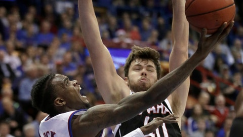 Kansas guard Lagerald Vick (2) shoots while covered by Nebraska-Omaha forward Matt Pile (40) during the first half of an NCAA college basketball game in Lawrence, Kan., Monday, Dec. 18, 2017. (AP Photo/Orlin Wagner)