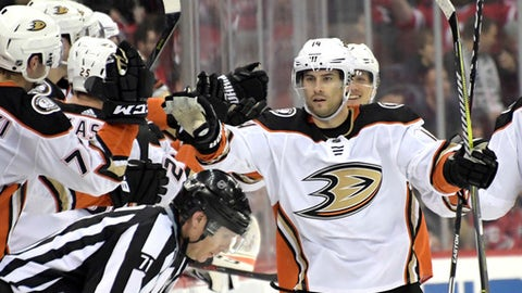 Anaheim Ducks center Adam Henrique (14) celebrates his goal during the second period of an NHL hockey game against the New Jersey Devils, Monday, Dec.18, 2017, in Newark, N.J. (AP Photo/Bill Kostroun)